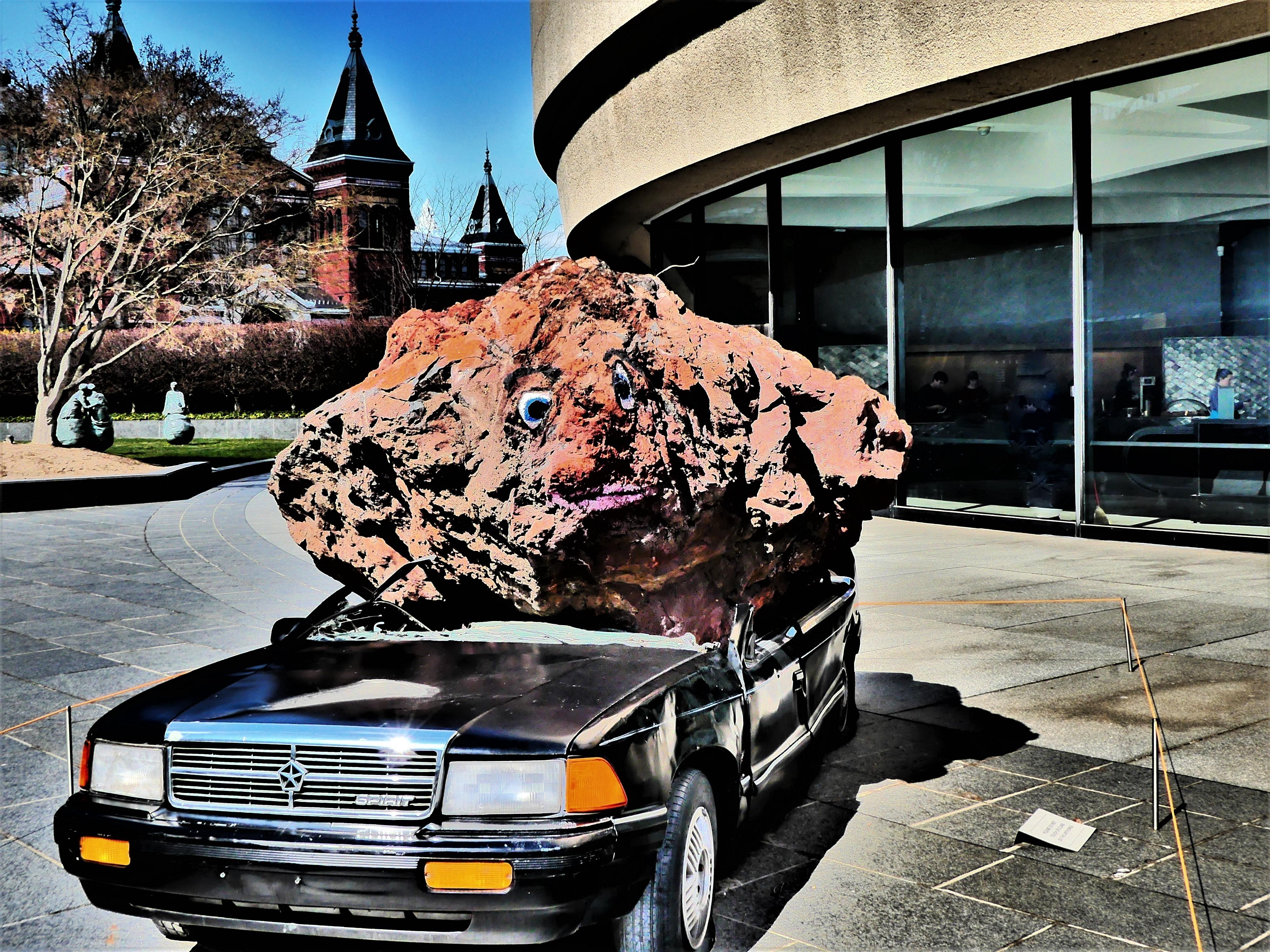 rockface and car