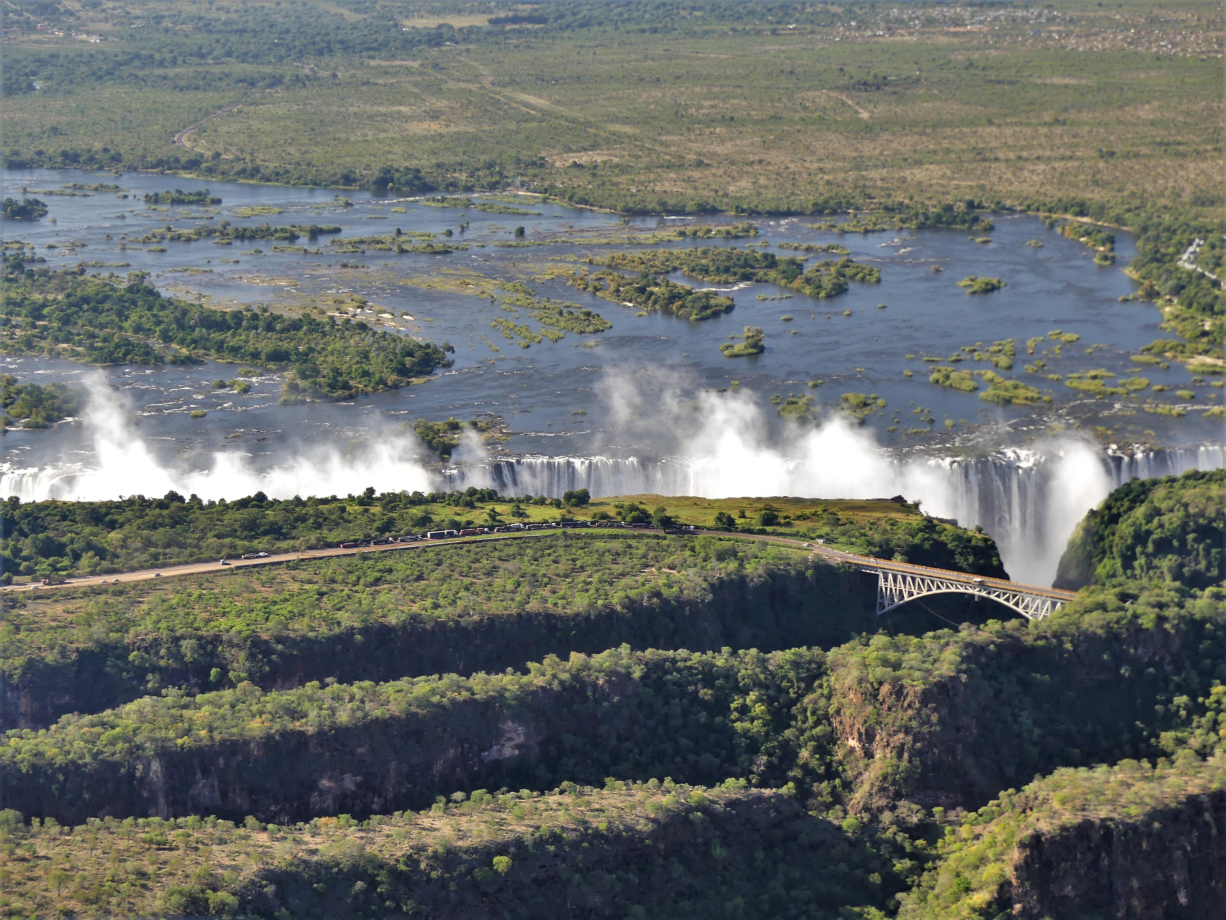 Zambezi River to falls with bridge.jpg