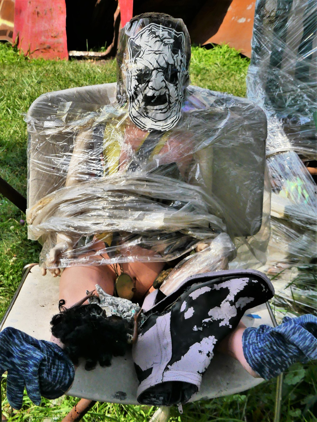 shrink wrapped doll